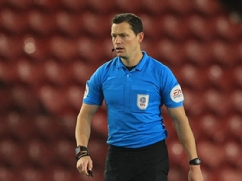 Referee Darren England.