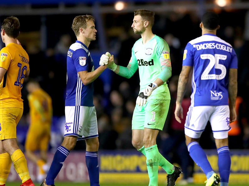 Kieftenbeld commiserates with Preston 'keeper Declan Rudd after the final whistle.