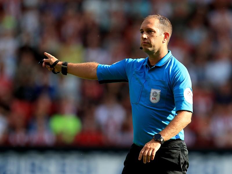 Referee Jeremy Simpson.