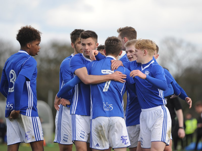 George Baker is congratulated by his teammates after scoring Blues' opener against Bolton.