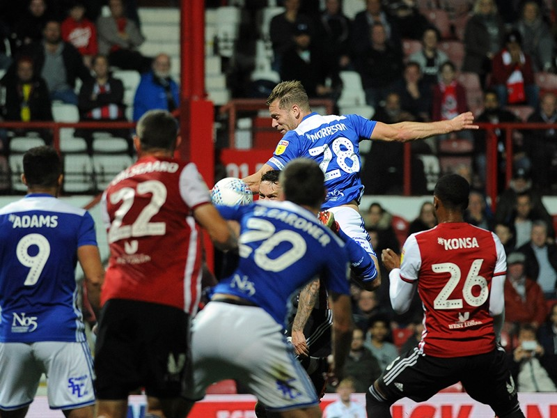 Michael Morrison heads home Blues' opener at Griffin Park.