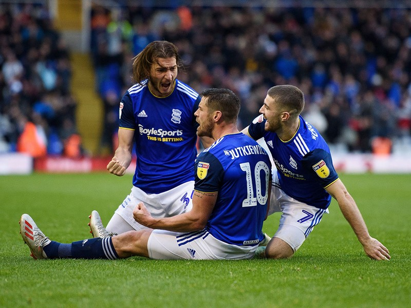 Lukas Jutkiewicz is congratulated by Ivan Sunjic and Dan Crowley after bagging the winner against Luton Town.