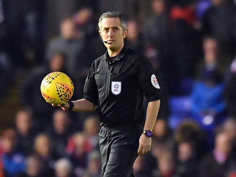 Referee Darren Bond.