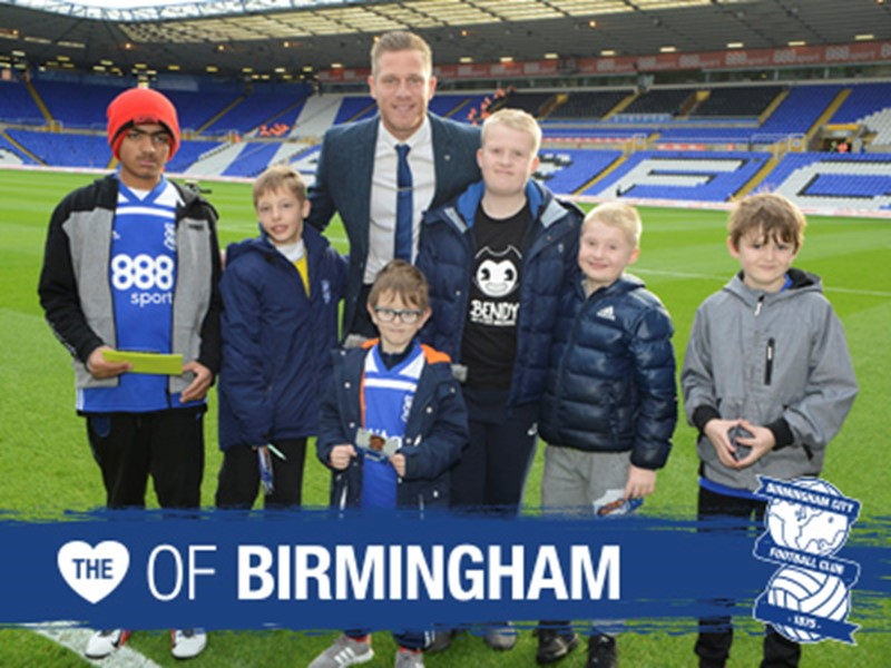 Blues captain Michael Morrison with members of the Community Trust's junior disability team.