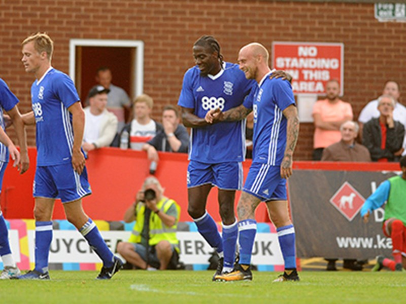 Clayton Donaldson receives the congratulations of his team-mates after netting Blues' equaliser.