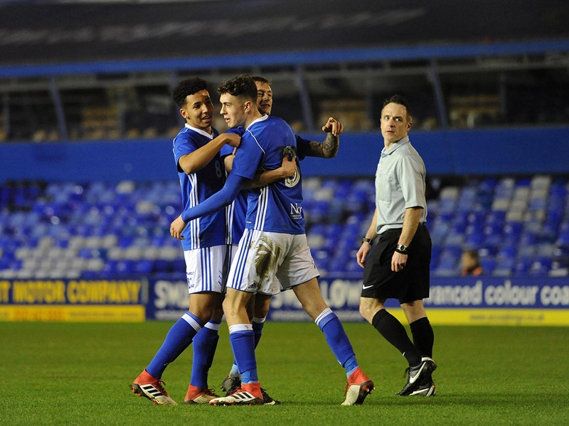 Corey O'Keeffe is congratulated by his teammates after scoring Blues' second goal.