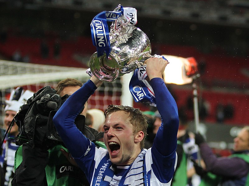 Seb Larsson lifting the Carling Cup with Blues,