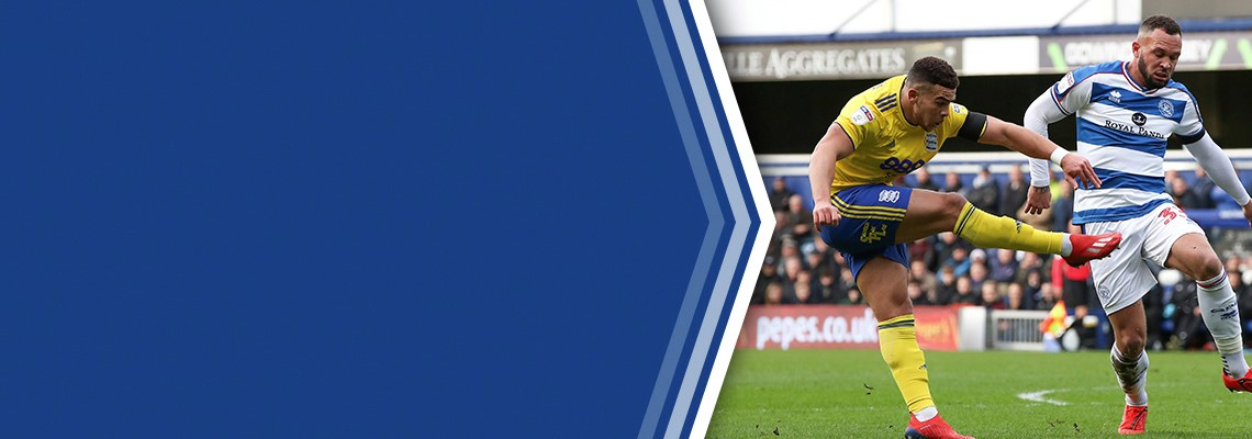 Che Adams scores the first of his three goals at QPR