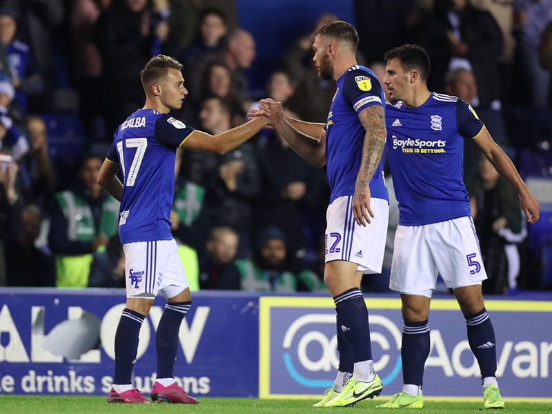 Fran Villalba celebrates Blues' goal against Blackburn with Harlee Dean and Maxime Colin.