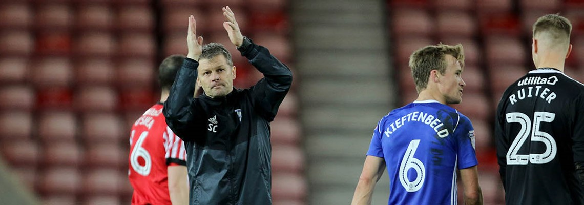 Steve Cotterill salutes the fans at Sunderland