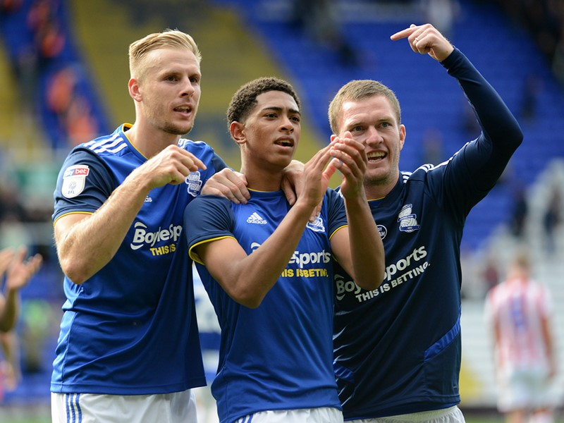Goalscorer Jude Bellingham celebrates with Blues teammates Marc Roberts and Craig Gardner.