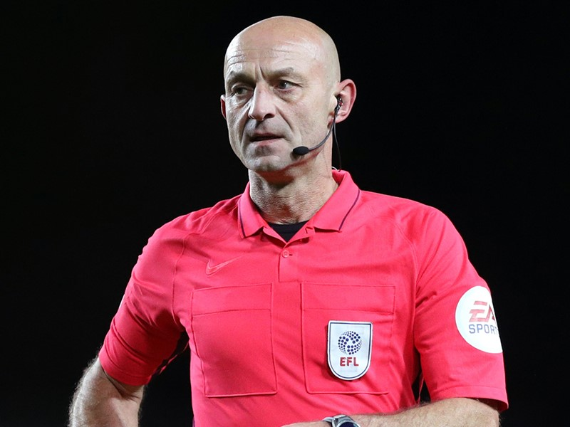 Referee Roger East.