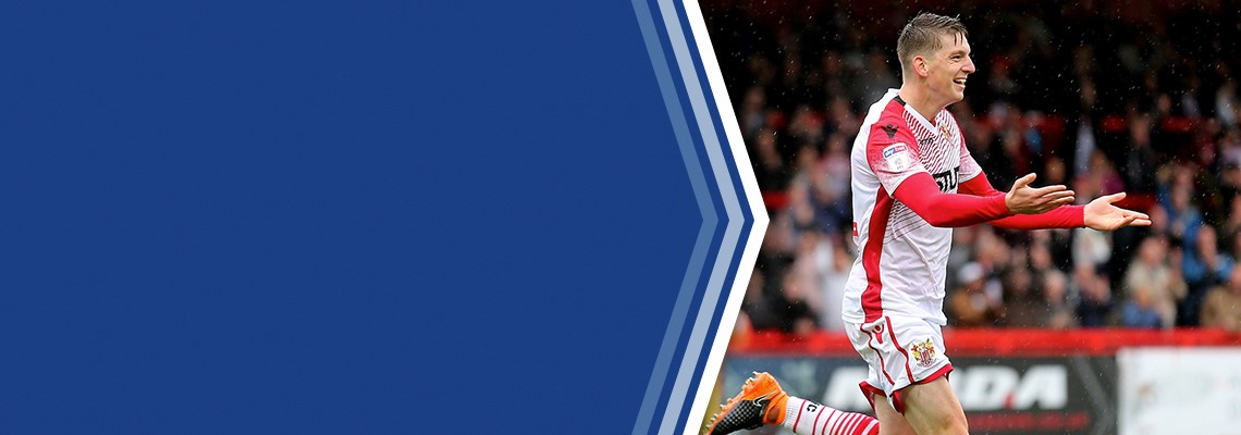 Steve Seddon celebrates after scoring Stevenage's winner.