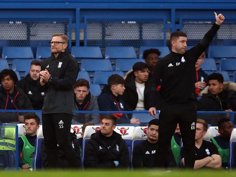 Steve Spooner and Karl Hooper on the sidelines at Stamford Bridge.