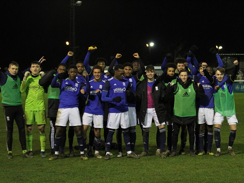 The Blues players celebrate their win against The Tykes.