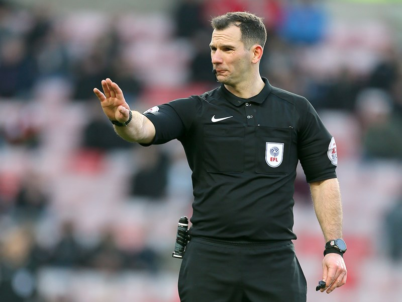 Referee Tim Robinson.
