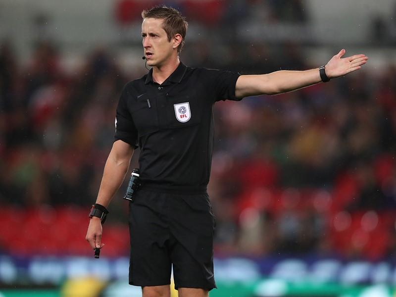 Referee John Brooks.